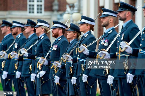 Graduating cadets line up at the Graduation Ceremony of the Queens Squadron and Sovereigns Review attended by Marshal of The Royal Air Force,...