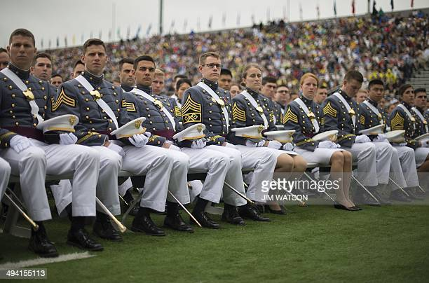 Graduating cadets listen as US President Barack Obama delivers the commencement address to the 2014 graduating class at the United States Military...