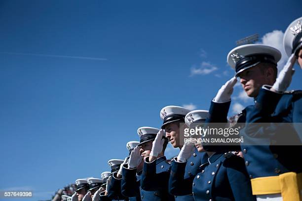 Graduating cadets listen to the US national anthem during a graduation ceremony at the US Air Force Academy's Falcon Stadium June 2 2016 in Colorado...