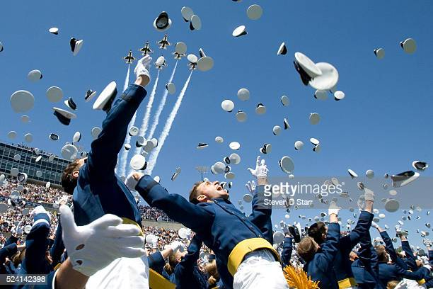 Graduating cadets toss their hats in the air to celebrate their graduation as the US Air Force Thunderbirds fly over Falcon Stadium after the 2009 US...