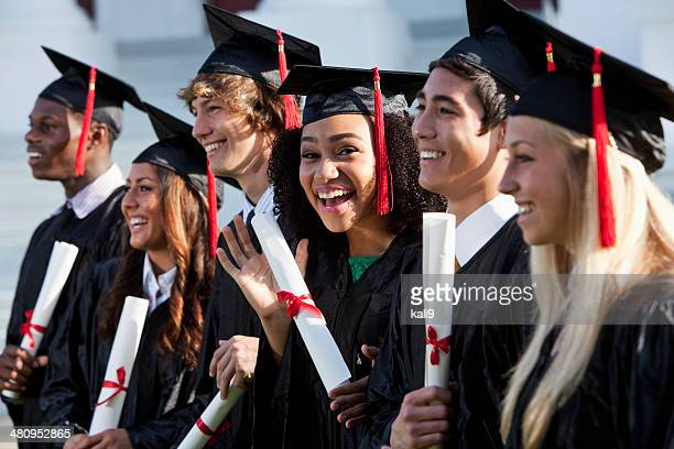 graduating class - graduation clothing stock pictures, royalty-free photos & images