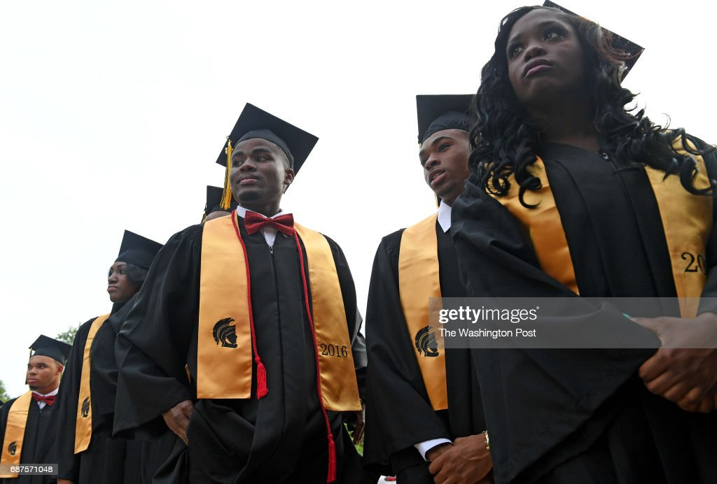 Graduating seniors from East Side High School wait for the