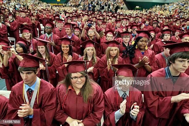 Graduating seniors of Joplin High School applaud U.S. President Barack Obama after his speech Monday night during the Joplin High School Commencement...