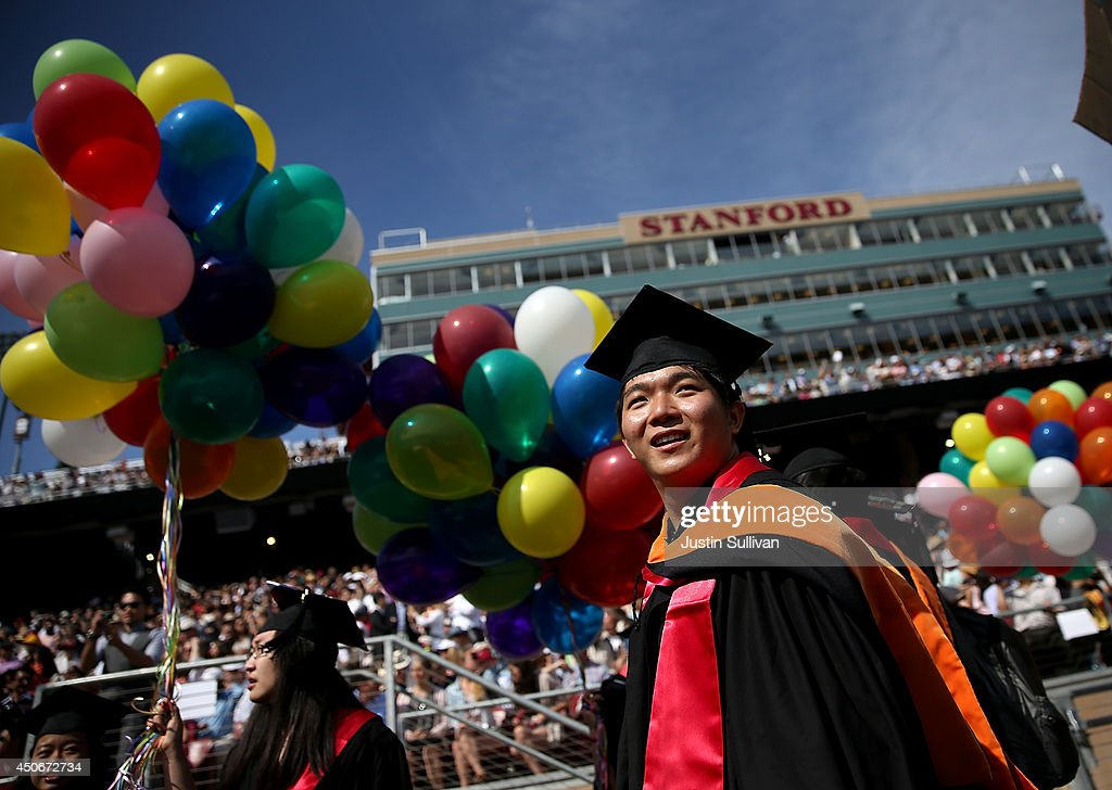 Graduating Stanford University students partcipate in the 'Wacky Walk' before the start of the 123rd Stanford commencement ceremony June 15, 2014 in Stanford, California. Microsoft founder and chairman Bill Gates and wife Melinda Gates shared the stage to deliver the commencement speech to Stanford University graduates.