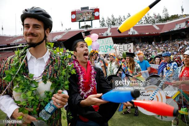 Graduating Stanford University students participate in the 'Wacky Walk' before the 128th Stanford University commencement ceremony on June 16, 2019...