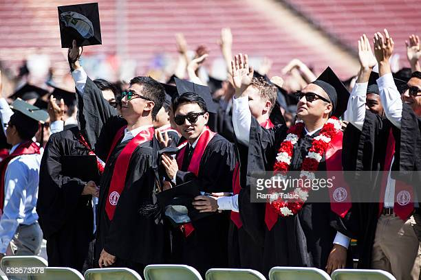 Graduating Stanford University students turn around to thank their parents during the 125th Stanford University commencement ceremony on June 12,...