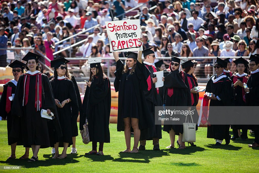 Graduating student, Andrea Lorei, who help organize campus demonstrations holds a sign in protest during the 'Wacky Walk' before the 125th Stanford University commencement ceremony on June 12, 2016 in Stanford, California. The university holds its commencement ceremony amid an on-campus rape case and its controversial sentencing.