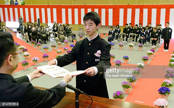 A graduating student of the Okuma Junior High School which used to be located 4 km from the crippled Fukushima Daiichi Nuclear Power Plant receives...