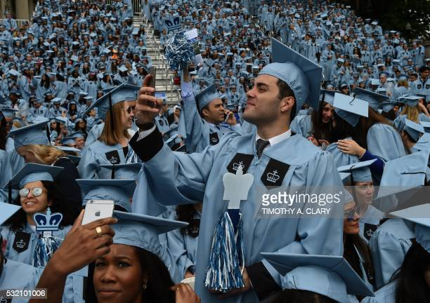 TOPSHOT Graduating students arrive for the Columbia University 2016 Commencement ceremony in New York May 18 2016 / AFP PHOTO / TIMOTHY A CLARY