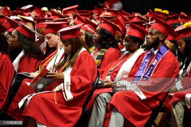 Graduating students look on during the Winston-Salem State University commencement at Lawrence Joel Veterans Memorial Coliseum on May 10, 2019 in...