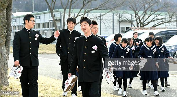 Graduating students of the Okuma Junior High School which used to be located 4 km from the crippled Fukushima Daiichi Nuclear Power Plant walk to...