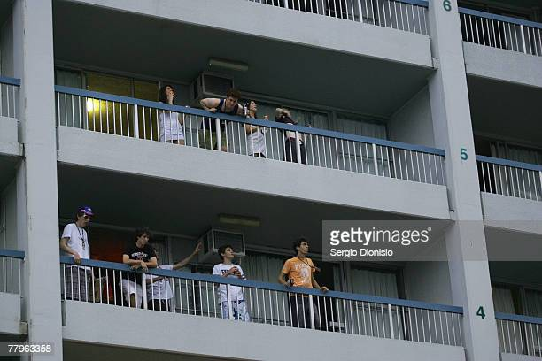 Graduating students party on the balcony of their hotel rooms during the first Schoolies celebrations following the end of the year 12 exams on...