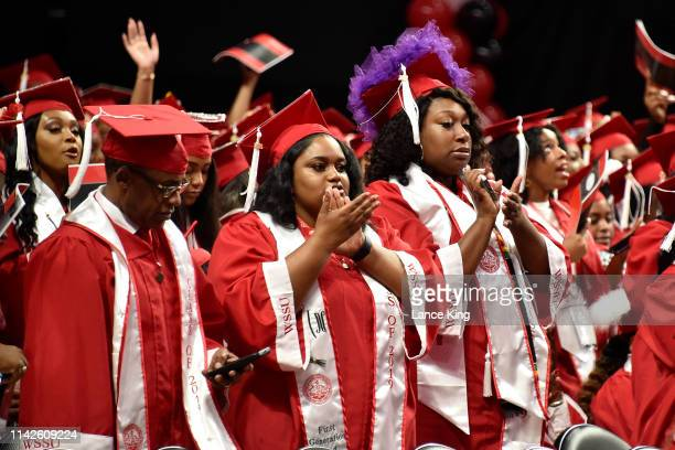 Graduating students react during the Winston-Salem State University commencement at Lawrence Joel Veterans Memorial Coliseum on May 10, 2019 in...