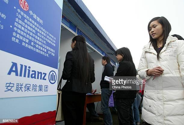 A graduating university student views recruitment advertisement of an insurance company at a job fair on November 26 2008 in Chengdu of Sichcuan...