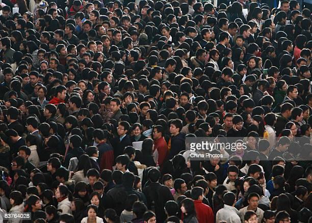 Graduating university students crowd a job fair on November 20 2008 in Nanjing of Jiangsu Province China The number of university graduates in China...