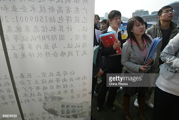 Graduating university students line up for an interview at a job fair on November 26 2008 in Chengdu of Sichcuan Province China The number of Chinese...