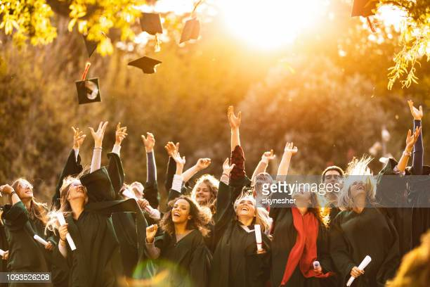 graduation day at sunset! - alumni stock pictures, royalty-free photos & images