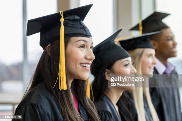 graduation day for multi-ethnic group - graduation stock pictures, royalty-free photos & images