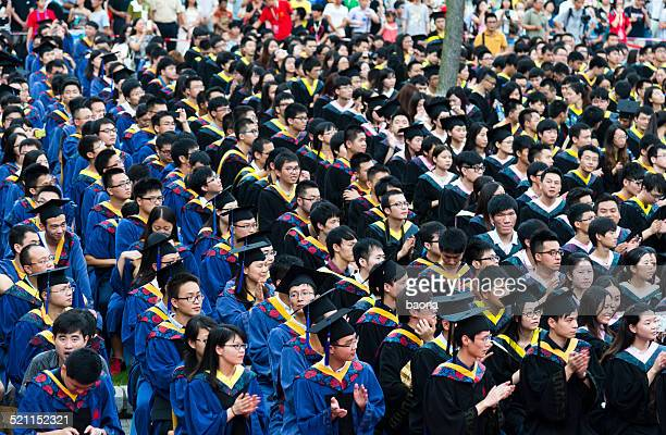 graduation day - graduation crowd stock pictures, royalty-free photos & images