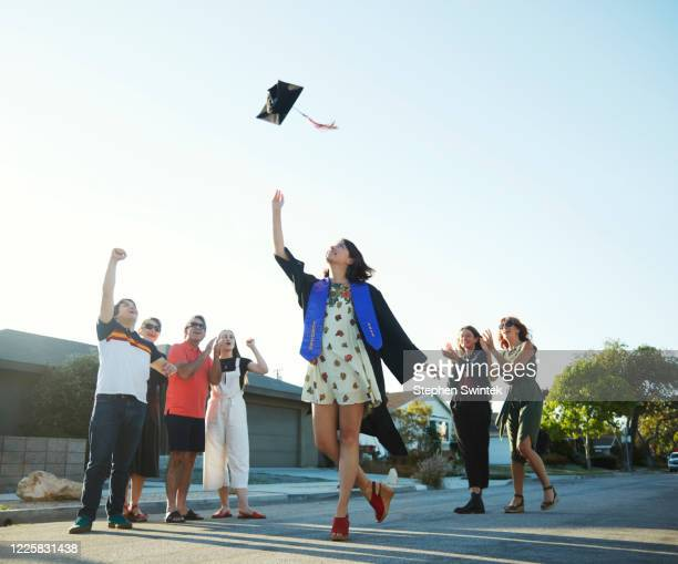 Graduation hat toss in the street