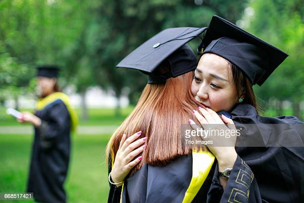 graduation hugs in campus - black hairy women stock pictures, royalty-free photos & images