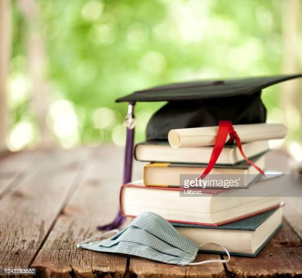 graduation in the era of covid-19 - diploma foto e immagini stock