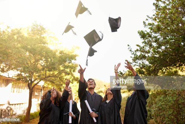 graduation is a time for celebrating an achievement - diploma stock pictures, royalty-free photos & images
