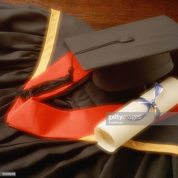 Graduation robes, cap and diploma