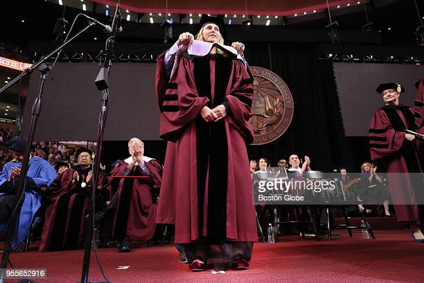 Graduation speaker Aimee Mullins gets her hood during the Northeastern University commencement at the TD Garden in Boston on May 4 2018