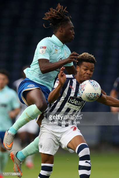 Grady Diangana of West Bromwich Albion and Osman Kakay of Queens Park Rangers during the Sky Bet Championship match between West Bromwich Albion and...
