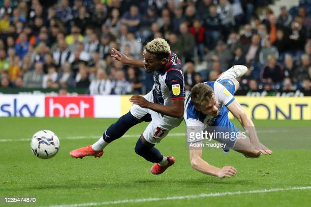 Grady Diangana of West Bromwich Albion and Rob Dickie of Queens Park Rangers during the Sky Bet Championship match between West Bromwich Albion and...