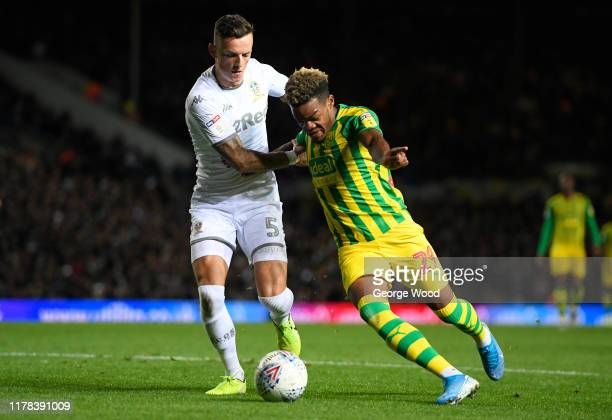Grady Diangana of West Bromwich Albion battles for the ball with Ben White of Leeds United during the Sky Bet Championship match between Leeds United...