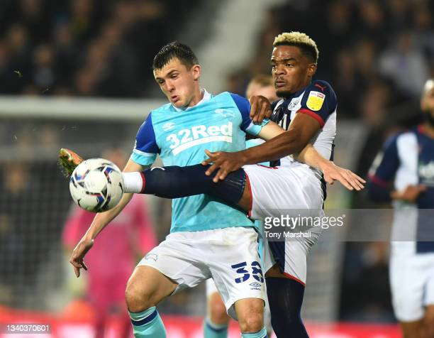 Grady Diangana of West Bromwich Albion battles for the ball with Jason Knight of Derby County during the Sky Bet Championship match between West...