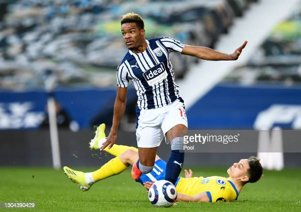 Grady Diangana of West Bromwich Albion runs with the ball away from Leandro Trossard of Brighton and Hove Albion during the Premier League match...