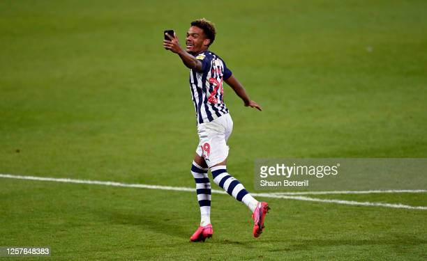 Grady Diangana of West Bromwich celebrate through his telephone to his family after the Sky Bet Championship match between West Bromwich Albion and...