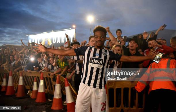 Grady Diangana of West Bromwich celebrate with the fans outside the stadium after the Sky Bet Championship match between West Bromwich Albion and...