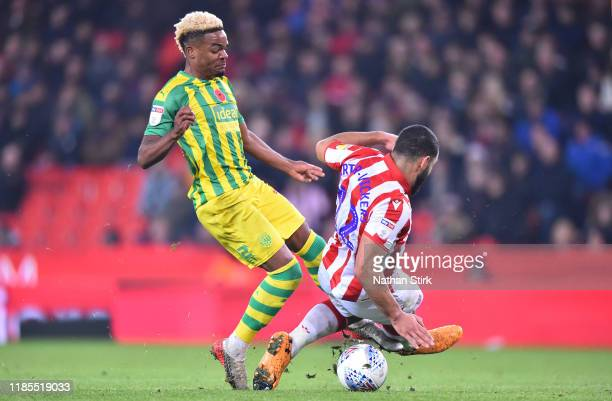 Grady Diangana of West Bromwich is awarded a penalty after Cameron CarterVickers of Stoke City miss times a tackle during the Sky Bet Championship...