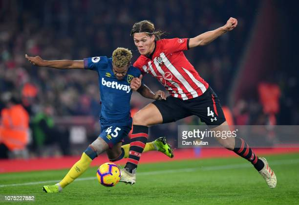 Grady Diangana of West Ham United battles for possession with Jannik Vestergaard of Southampton during the Premier League match between Southampton...