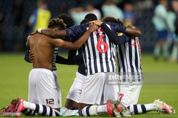 Grady Diangana Semi Ajayi Filip Krovinovic Matheus Pereira and Rekeem Harper of West Bromwich Albion embrace as they celebrate promotion to the...