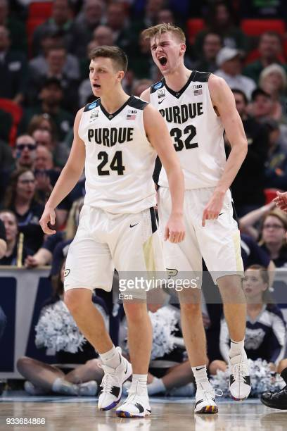 Grady Eifert and Matt Haarms of the Purdue Boilermakers react during the first half against the Butler Bulldogs in the second round of the 2018 NCAA...