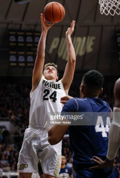 Grady Eifert of the Purdue Boilermakers shoots the ball over Julian Moore of the Penn State Nittany Lions at Mackey Arena on February 18 2018 in West...