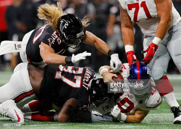 Grady Jarrett and Brooks Reed of the Atlanta Falcons sack Eli Manning of the New York Giants at Mercedes-Benz Stadium on October 22, 2018 in Atlanta,...