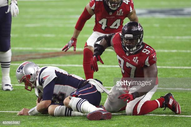 Grady Jarrett of the Atlanta Falcons celebrates after sacking Tom Brady of the New England Patriots during the fourth quarter during Super Bowl 51 at...