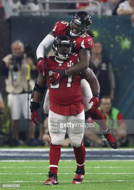 Grady Jarrett of the Atlanta Falcons celebrates with Jonathan Babineaux after sacking Tom Brady of the New England Patriots during the fourth quarter...