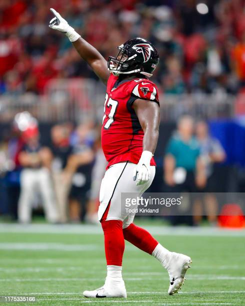 Grady Jarrett of the Atlanta Falcons reacts after a stop during the first half of an NFL game against the Philadelphia Eagles at Mercedes-Benz...