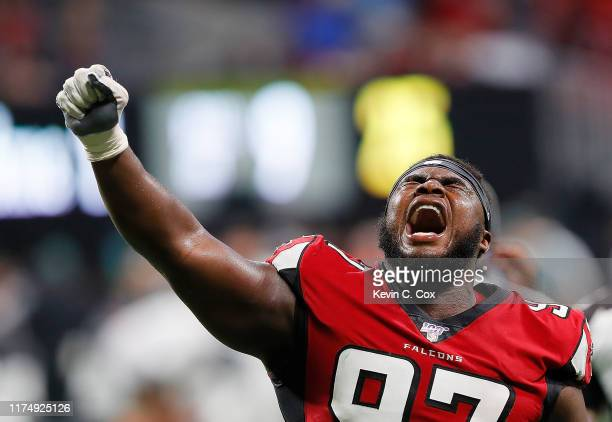 Grady Jarrett of the Atlanta Falcons reacts after a video review confirmed the Philadelphia Eagles failed to convert a fourth down in the final...