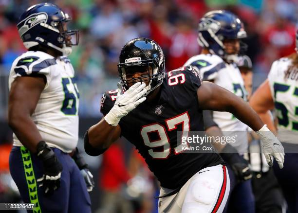 Grady Jarrett of the Atlanta Falcons reacts after sacking Russell Wilson of the Seattle Seahawks in the second half at Mercedes-Benz Stadium on...