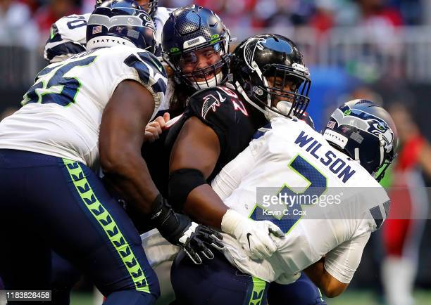 Grady Jarrett of the Atlanta Falcons sacks Russell Wilson of the Seattle Seahawks in the second half at Mercedes-Benz Stadium on October 27, 2019 in...