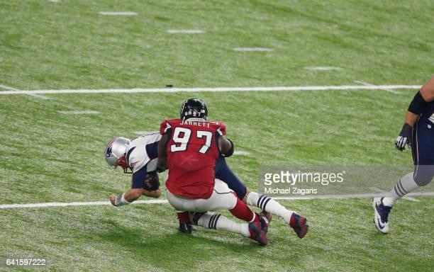 Grady Jarrett of the Atlanta Falcons sacks Tom Brady of the New England Patriots during Super Bowl 51 at NRG Stadium on February 5, 2017 in Houston,...