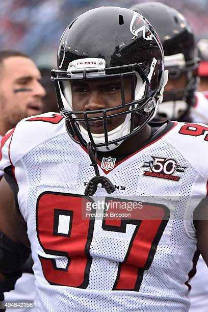 Grady Jarrett of the Atlanta Falcons watches from the sideline during a game against the Tennessee Titans at Nissan Stadium on October 25 2015 in...
